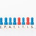 Text Hepatitis B written on wooden blocks with pawns in various colors on white background