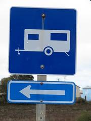 'Caravan Park/Site to the left' traffic signs (RS 1990) Tags: australia southaustralia trafficsign milang adelaide sunday 25th august 2019 caravan arrow blue