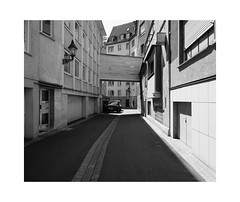 There might really be a Sunny Side of the Street (Thomas Listl) Tags: road street city bridge summer urban blackandwhite sunlight monochrome lines facade grey vanishingpoint noiretblanc space wideangle mundane würzburg urbanlandscape topography biancoenegro thomaslistl