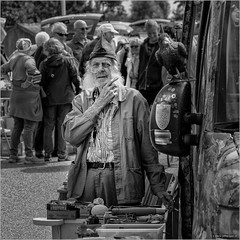 Trunk sales in Makkum (John Riper) Tags: johnriper street photography straatfotografie square vierkant bw black white zwartwit mono monochrome netherlands john riper fryslân makkum visserijdagen 2019 friesland frisian old man sixties hippy trunk sales kofferbak verkoop bird car people eye contact south uist