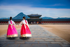 Asian girl in korean dress walking infront of gate of  gyeongbokgung palace (anekphoto) Tags: togather friends walking walk beautiful happy seoul gate gyeongbokgung gyeongbok woman autumn travel girl hanbok outdoor portrait street historic famous tourist landmark tourism dress red palace lady culture clothes people korean asian asia green pretty tradition young south city colorful background traditional korea ancient dressed old town costume female model
