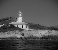 Looking back (Stu Thatcher) Tags: water sea lighthouse black white bw mono stuart thatcher canon 7d mk2 majorca spain