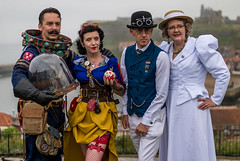 I'll trade you - one helmet for that apple. (daveseargeant) Tags: sea festival coast seaside yorkshire north coastal whitby steampunk 2019 street cosplay 50mm nikon df 18g candid