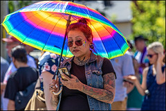 Ottawa Pride Parade 2019 - 5 (Dan Dewan) Tags: dandewan bankstreet canonef70200mm14lisusm street people canon ottawapride tattoo colour lady sunglasses summer ottawa phone sunday portrait prideparade woman august canoneos7dmarkii canada glasses 2019 girl ontario