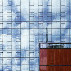 Blue and Red (Nick Condon) Tags: abstract architecture building chicago clouds olympus45mm olympusem10 reflection sky urban wall window