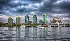 False Creek reflections (Christie : Colour & Light Collection) Tags: vancouver cityofvancouver falsecreek expo86 nikkor nikon flickr outdoors outside reflections waterreflections buildings cloudy clouds moody stormy omimax dome golfball bc britishcolumbia sky geodesic 1986 geodesicdome scienceworld boats moored kayak skyscrapers worldfaircentre telusworldofscience canada shoreline dslr photography worldclasscity heartofvancouver dramatic