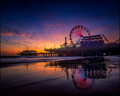 Carnival Lights (PrevailingConditions) Tags: color colorful landscape surf carnival santamonica pier ocean losangeles ca california sunset neon reflection water longexposure