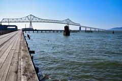 Astoria river walk (James_D_Images) Tags: astoria oregon columbiariver riverwalk boardwalk tramline tracks astoriameglerbridge bridge span pilings pier history pacificnorthwest perspective