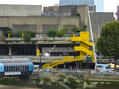 Turning Architecture into a Playground (Steve Taylor (Photography)) Tags: heartstopping zemran williampyewater sculpture icecreamvan southbankcentre festivalpier river thames embankment architecture sign banner stairs steps staircase blue green brown yellow uk gb england greatbritain unitedkingdom london