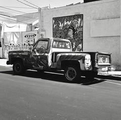 Graffito (Film3688) Tags: hasselblad hasselblad500cm zeiss80mm zeiss carlzeiss mediumformat 120mm 120 120film analog film graffiti cars trucks blackandwhite monochrome