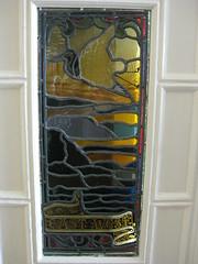 "An Art Nouveau Stained Glass Panel in the Front Door of ""The Gables"" Queen Anne Villa - Finch Street, East Malvern (raaen99) Tags: door frontdoor thegables housename queenannehouse federationhouse queenannefederationhouse gascoigneestate stainedglass stainedglasswindow stainedglasswindows artnouveaustainedglass artnouveaustainedglasswindow baywindow finchstreet finchst queenannestyle queenanne federation window edwardian edwardiana melbourne victoria australia domesticarchitecture house home architecture melbournearchitecture housing 20thcentury twentiethcentury artnouveau nouveau 1900s 1902 malvern eastmalvern artsandcrafts artsandcraftsmovement artscraftsmovement artscrafts architecturallydesigned beverleyussher henrykemp ussherandkemp ussherkemp lawrencealfredbirchnell lawrencebirchnell detail interior room entrance entrancehall hall foyer leaves vine yellow green red crane stork bird blue"