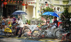 Penang Street (-Faisal Aljunied - !!) Tags: faisalaljunied penang georgetown malaysia rickshaw umbrella sonya6400 temple lanterns