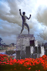 The Emancipation Statue, Barbados (Old Londoner) Tags: emancipation redflowers publicstatue bridgetown barbados westindies caribbean bussa
