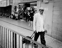 Arriving (Bone Setter) Tags: streetphotography birmingham candid digbeth coachstation man chinese pushed blackwhite ilford hp5 fumanchu
