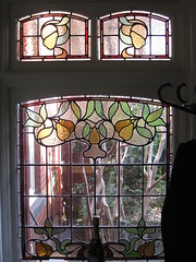 """An Art Nouveau Stained Glass Window in the Dressing Room of """"The Gables"""" Queen Anne Villa - Finch Street, East Malvern (raaen99) Tags: stainedglass housename thegables gascoigneestate federationhouse queenannehouse queenannefederationhouse house home window architecture queenanne australia melbourne victoria artnouveau housing malvern nouveau 20thcentury stainedglasswindow edwardian federation 1900s artsandcraftsmovement artsandcrafts stainedglasswindows 1902 baywindow artscrafts domesticarchitecture twentiethcentury melbournearchitecture queenannestyle artscraftsmovement eastmalvern edwardiana finchstreet henrykemp finchst artnouveaustainedglass architecturallydesigned artnouveaustainedglasswindow beverleyussher ussherandkemp ussherkemp lawrencealfredbirchnell lawrencebirchnell detail green leaves yellow fruit leaf branch pears interior room vine dressingroom pear"""