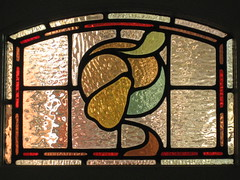 """An Art Nouveau Stained Glass Vent Window in the Dressing Room of """"The Gables"""" Queen Anne Villa - Finch Street, East Malvern (raaen99) Tags: thegables housename queenannehouse federationhouse queenannefederationhouse gascoigneestate stainedglass stainedglasswindow stainedglasswindows artnouveaustainedglass artnouveaustainedglasswindow baywindow finchstreet finchst queenannestyle queenanne federation window edwardian edwardiana melbourne victoria australia domesticarchitecture house home architecture melbournearchitecture housing 20thcentury twentiethcentury artnouveau nouveau 1900s 1902 malvern eastmalvern artsandcrafts artsandcraftsmovement artscraftsmovement artscrafts architecturallydesigned beverleyussher henrykemp ussherandkemp ussherkemp lawrencealfredbirchnell lawrencebirchnell detail interior room dressingroom fruit pears pear vine branch leaves leaf yellow green"""