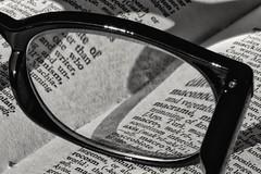 Reading glasses & book (phileveratt) Tags: macromondays goestogetherlike glasses readingglasses book monochrome blackwhite
