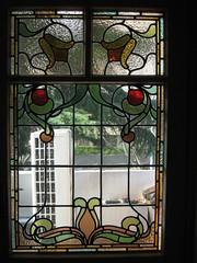 """The Art Nouveau Stained Glass Window of the Upstairs Bedroom of """"The Gables"""" Queen Anne Villa - Finch Street, East Malvern (raaen99) Tags: thegables housename queenannehouse federationhouse queenannefederationhouse gascoigneestate stainedglass stainedglasswindow stainedglasswindows artnouveaustainedglass artnouveaustainedglasswindow baywindow finchstreet finchst queenannestyle queenanne federation window edwardian edwardiana melbourne victoria australia domesticarchitecture house home architecture melbournearchitecture housing 20thcentury twentiethcentury artnouveau nouveau 1900s 1902 malvern eastmalvern artsandcrafts artsandcraftsmovement artscraftsmovement artscrafts architecturallydesigned beverleyussher henrykemp ussherandkemp ussherkemp lawrencealfredbirchnell lawrencebirchnell detail interior room bedroom fruit leaves vine orange yellow green red flowers floral flora"""