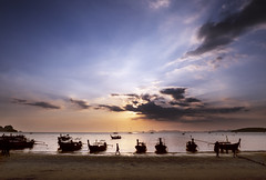Railay Beach (Bernd Schunack) Tags: railay beach longtail boat sunset backlight fantastic light rocks cliffs water ocean andaman sea clouds silhouette paradise krabi sun horizon thailand panasonic lumix gx9
