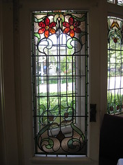 """The Art Nouveau Stained Glass Door Panel of the Conservatory of """"The Gables"""" Queen Anne Villa - Finch Street, East Malvern (raaen99) Tags: thegables housename queenannehouse federationhouse queenannefederationhouse gascoigneestate stainedglass stainedglasswindow stainedglasswindows artnouveaustainedglass artnouveaustainedglasswindow baywindow finchstreet finchst queenannestyle queenanne federation window edwardian edwardiana melbourne victoria australia domesticarchitecture house home architecture melbournearchitecture housing 20thcentury twentiethcentury artnouveau nouveau 1900s 1902 malvern eastmalvern artsandcrafts artsandcraftsmovement artscraftsmovement artscrafts architecturallydesigned beverleyussher henrykemp ussherandkemp ussherkemp lawrencealfredbirchnell lawrencebirchnell flower flora feature detail interior room conservatory door doorpanel panel"""