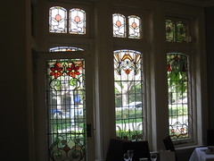 """The Three Art Nouveau Stained Glass Windows of the Drawing Room and the Door of the Conservatory of """"The Gables"""" Queen Anne Villa - Finch Street, East Malvern (raaen99) Tags: thegables housename queenannehouse federationhouse queenannefederationhouse gascoigneestate stainedglass stainedglasswindow stainedglasswindows artnouveaustainedglass artnouveaustainedglasswindow baywindow finchstreet finchst queenannestyle queenanne federation window edwardian edwardiana melbourne victoria australia domesticarchitecture house home architecture melbournearchitecture housing 20thcentury twentiethcentury artnouveau nouveau 1900s 1902 malvern eastmalvern artsandcrafts artsandcraftsmovement artscraftsmovement artscrafts architecturallydesigned beverleyussher henrykemp ussherandkemp ussherkemp lawrencealfredbirchnell lawrecebirchnell detail interior room drawingroom lounge"""