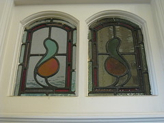 """The Art Nouveau Stained Glass Vent Window Above the Lancet Window of the Dining Room of """"The Gables"""" Queen Anne Villa - Finch Street, East Malvern (raaen99) Tags: thegables housename queenannehouse federationhouse queenannefederationhouse gascoigneestate stainedglass stainedglasswindow stainedglasswindows artnouveaustainedglass artnouveaustainedglasswindow baywindow finchstreet finchst queenannestyle queenanne federation window edwardian edwardiana melbourne victoria australia domesticarchitecture house home architecture melbournearchitecture housing 20thcentury twentiethcentury artnouveau nouveau 1900s 1902 malvern eastmalvern artsandcrafts artsandcraftsmovement artscraftsmovement artscrafts architecturallydesigned beverleyussher henrykemp ussherandkemp ussherkemp lawrencealfredbirchnell lawrencebirchnell detail interior room diningroom fruit leaves vine orange green red"""