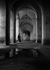 The man is walking (Fan.D & Dav.C Photgraphy) Tags: black and white architecture corridor arch indoors no people built structure history gothic style loneliness day church travel destinations diminishing perspective building exterior urban street capture city walking urbanstreet citywalk streetphotography streeturbainphotography