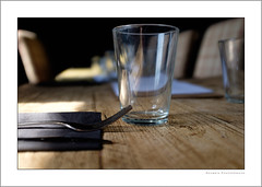 Out to lunch (G. Postlethwaite esq.) Tags: dof derbyshire fujix100t unlimitedphotos wirksworth bokeh cafe chairs depthoffield fork glass knife lunch napkin photoborder selectivefocus table
