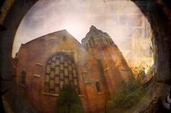 False Gospel (Crusty Da Klown (Busy)) Tags: gospel false marxism bible church lomo lomography fisheye kodak film analog lofi bc britishcolumbia canada building window big steeple architecture round circle