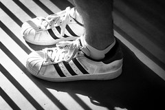 Go Faster Stripes - Explored (DobingDesign) Tags: shoes feet trainers sneakers adidas adidassuperstar blackandwhite abstract lines stripes thebrandwiththethreestripes foot leg ankles diagonals shadows lightandshadow laces