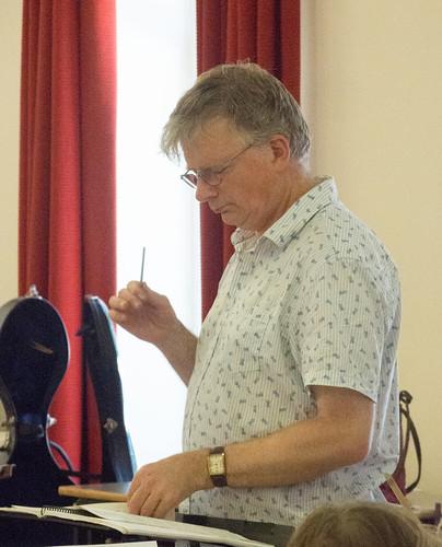 DSCN4617c Conductor John Gibbons rehearsing players from Ealing Symphony Orchestra for an informal concert as part of the Brill Festival. 24th August 2019.