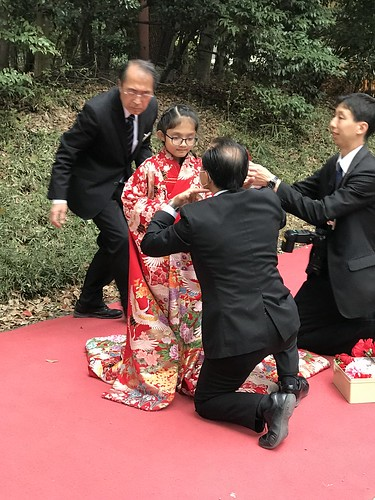 Another view of the kid getting decked up in a kimono