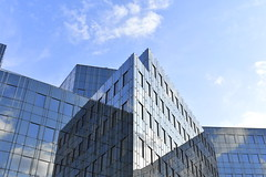 Illusory Dimensions (Robin Shepperson) Tags: architecture building berlin germany deutschland glass mirror illusion dimensions blue clouds angles windows facade summer sky degrees up straight sharp metal struts framework frame city office modern d3400 nikon edges reflection reflecting outside
