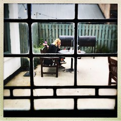 Watching and Waiting (Julie (thanks for 8 million views)) Tags: 100xthe2019edition 100x2019 image77100 thelocal window benches woman waiting glass picnictable outdoorseating dining fence hipstamaticapp dunbrodyhousehotel ireland irish wexford hbm iphone6s songlyrics themoodyblues watchingandwaiting