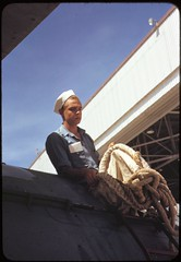 In the Navy: Sailor mechanic inspecting a PBY plane at the Naval Air Base, Corpus Christi, Texas, August 1942. (polkbritton) Tags: howardhollem 1940s worldwarii wwiihomefront wwii usnavy fsaowi libraryofcongresscollections texashistory corpuschristi