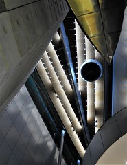 looking up (SM Tham) Tags: newzealand building architecture design interior structure auckland northisland queenstreet skyworldentertainmentcentre metal concrete cladding lighting shapes ceiling ventilator soffit cantilever balcony