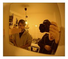 Lins & Spatz (Armin Fuchs) Tags: arminfuchs thomaslistl jazzinbaggies kitchen mirror reflection cookin linsspatz euterpflege stove 6x7 yellow camera fisheye kunstlicht artificiallight tungsten