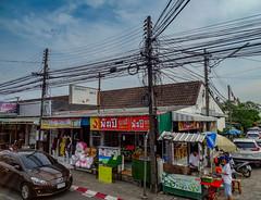 Wiring mayhem, Penang, Malaysia (Jenny Stokes Melbourne) Tags: green street streetscape wiring cables telegraph penang malaysia