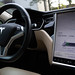 Tesla Model S interior and battery indicator shown on the touch screen, while using Supercharger charging network