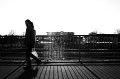 Man with bag (stefankamert) Tags: lines bridge shadows light street noir noiretblanc blackandwhite blackwhite ricoh gr grii bw stefankamert backlight