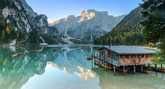 Lago Di Braies, Dolomites Italy (Michael Long Landscaper) Tags: 1635mm benro blue canon dramatic gitzo great horizon landmark landscape long nature old outdoor photo pier sands setting sky sun travel view water wet wood wooden light natural italy dolomites sunrise boat lagodibraies autumn boathouse reflection still fanessennesbraies park valpusteria exposure green clear mirror