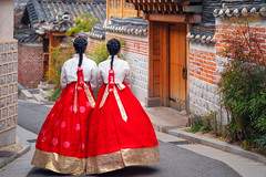 Korean lady in Hanbok or Korea dress and walk in an ancient town in seoul (anekphoto) Tags: together happy gyeongbokgung dress beauty hanbok smile red beautiful white female costume bukchon palace attractive town old girl ancient seoul korea traditional fashion walk travel lady culture blue outdoor people portrait korean asian asia green pretty art village tradition street hanok tourist tourism wear young south city color woman vintage