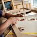 Carpenter fitting furniture parts together. Making furniture in a workshop