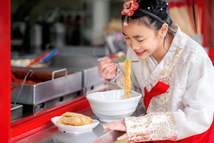 Korean girl eat a noodle with Korean traditional dress in old and vintage restaurant (anekphoto) Tags: udon vintage red dress costume old lunch korean korea breakfast asia asian hungry table lifestyle soup restaurant tourist appetizer tourism ramen chopstick girl face traditional enjoy hot hanbok food people female japanese chinese woman eat tasty meal bowl lady delicious smiling cuisine diet dish noodles cooking travel meat taiwanese famous