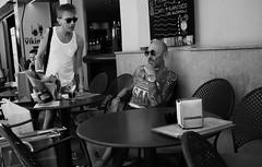 wait a friend (Isidre Cor) Tags: fuji x100 bn monochrome street photography barcelona blanco y negro fotografia callejera people gente isidre cor hyperfocal sitges