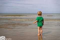 Searching the Sea (Mike House Photography) Tags: sea beach blue sky white clouds sand sandy glassy water watching seeking looking waves standing paddling toddler walking playing playful joy joyous fun funny happy happiness day sunny bright light