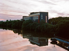 Closed Office at Dusk (Allegra non troppo) Tags: dusk medium format mamiya645 mamiya 1000s 120mm architecture reflection river building twighlight