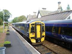 Trains passing at Dunkeld & Birnam, Perthshire (calderwoodroy) Tags: station scotland transport perthshire trains dunkeld railways birnam perthkinross dieselmultipleunits dunkeldbirnamstation platform railwaystation class158dmu 158735 class170dmu 170433 passingloop