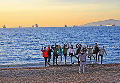 Sunset Pose (HereInVancouver) Tags: people photographer sunset posing group portrait beach sand water ocean pacific sunsetlight englishbay vancouverswestend city urban canon5d vancouver bc canada thingstodobythewater theotherphotographer