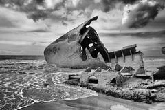bad maneuver (the ripped bystander) Tags: blackwhite seashore sky boat grounding destruction